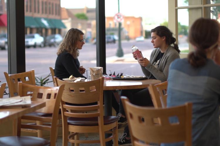 photo of women sitting in Co-op deli