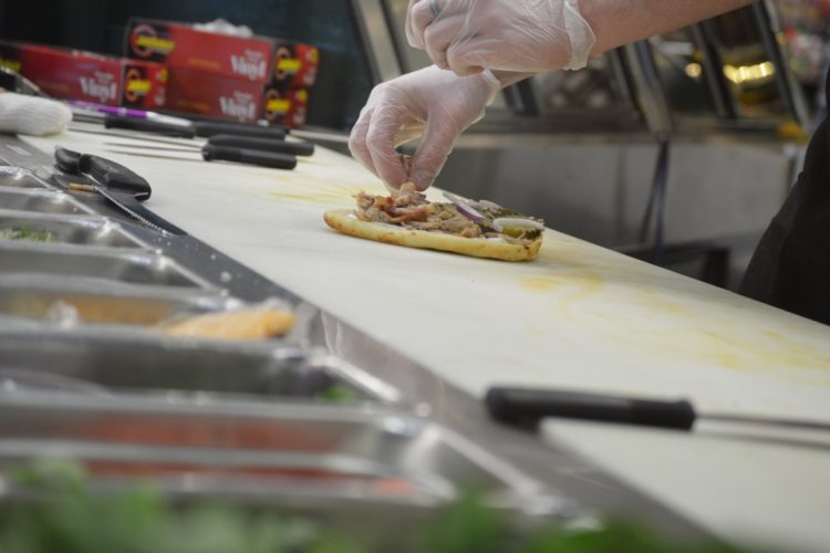 a photo of a sandwich being made in the St. Peter Food Co-op Deli