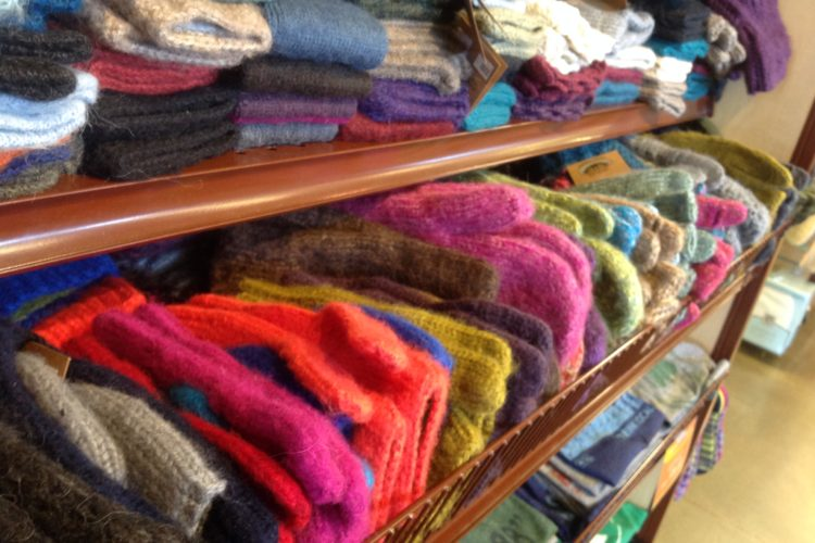 a photo of scarves and gloves at the St. Peter Food Co-op