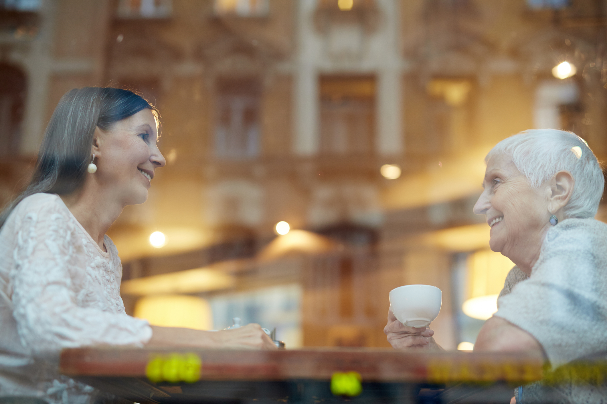 a photo of friends in a cafe window