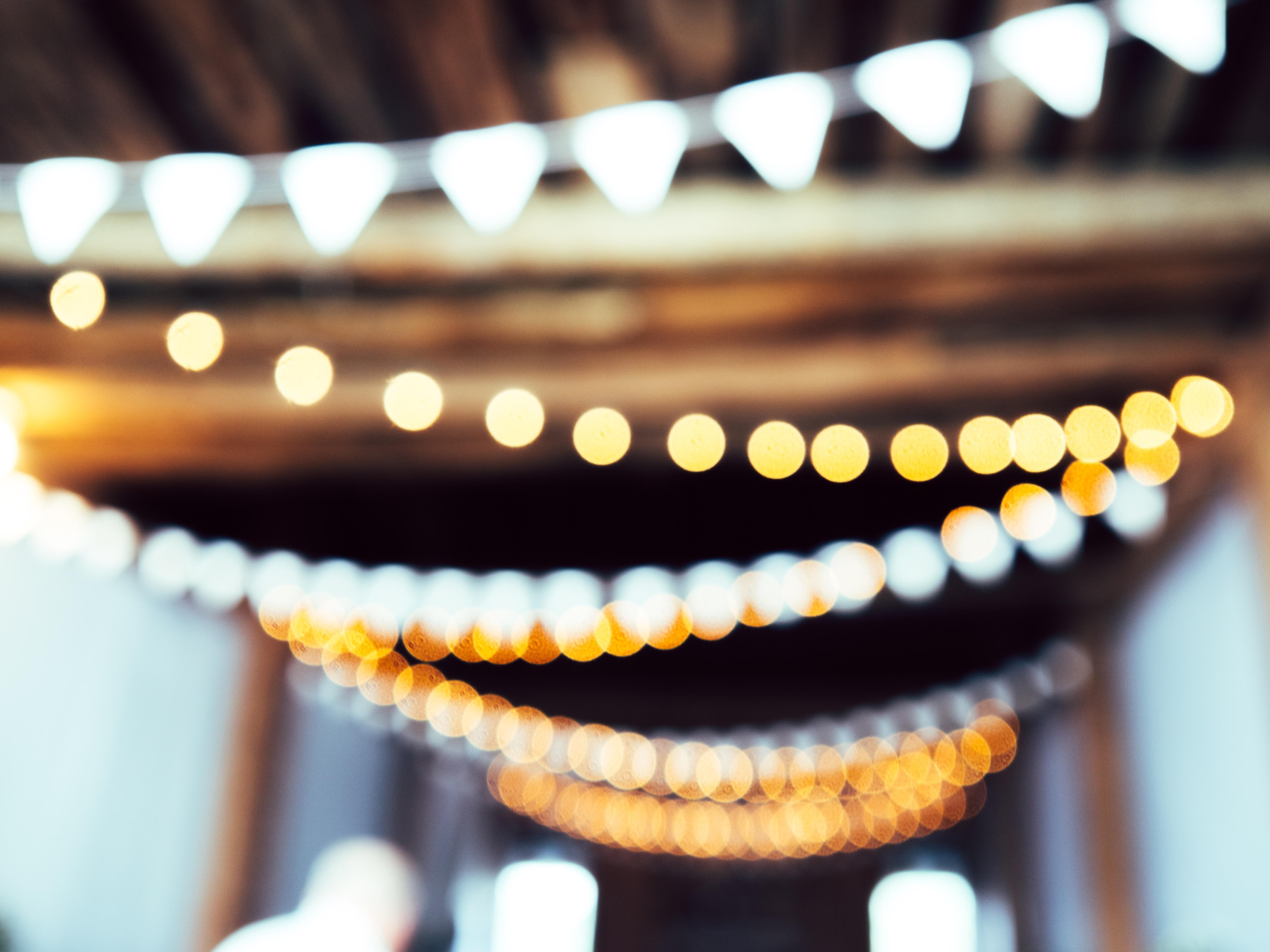 a photo of lights strung across a hallway