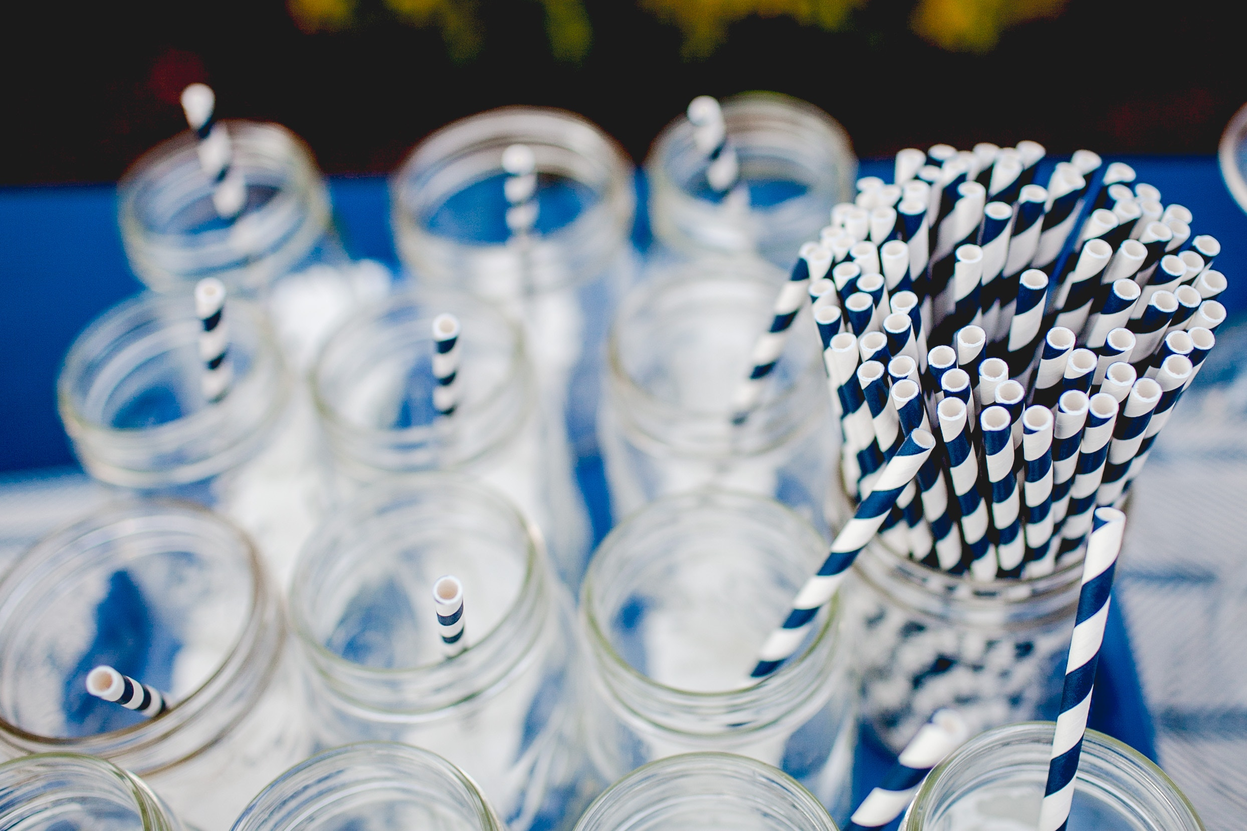 a photo of jars filled with paper party straws