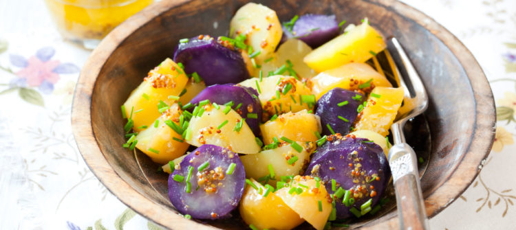 a photo of tricolored potato salad in a bowl