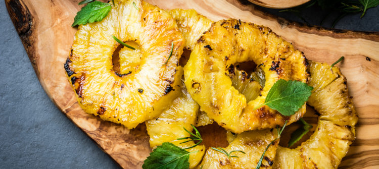 a photo of pineapple on the grill