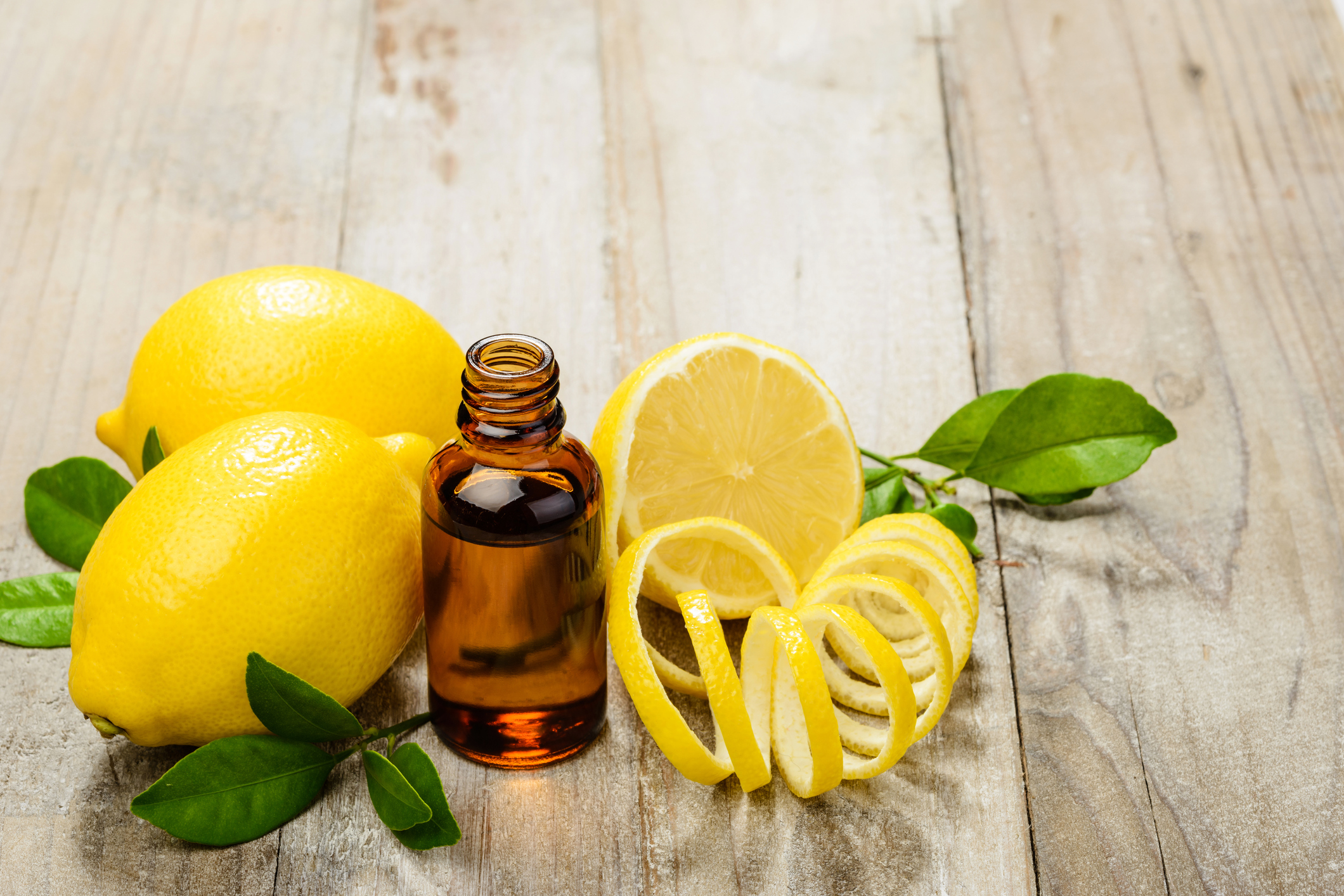a photo of a bottle of essentia oils and lemons