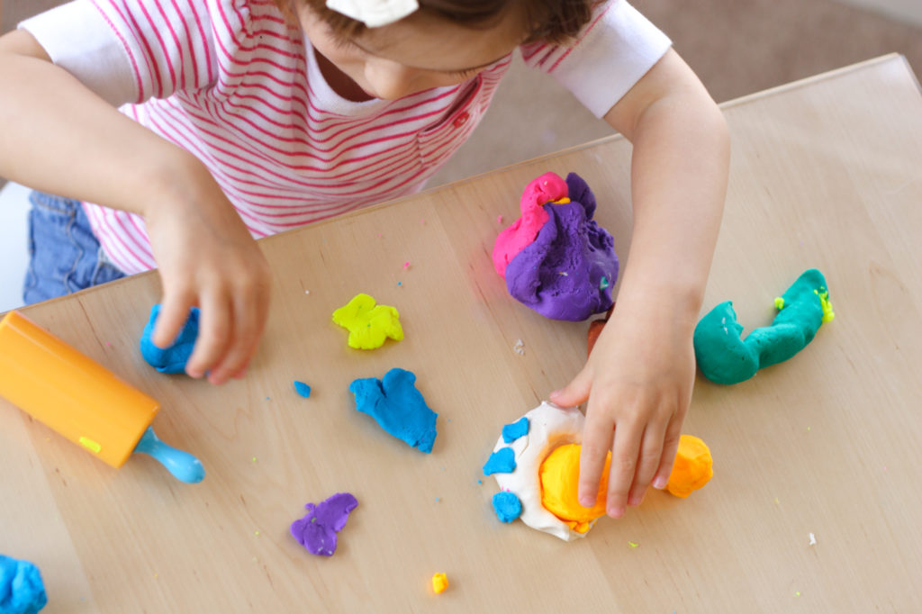 a child playing with play dough