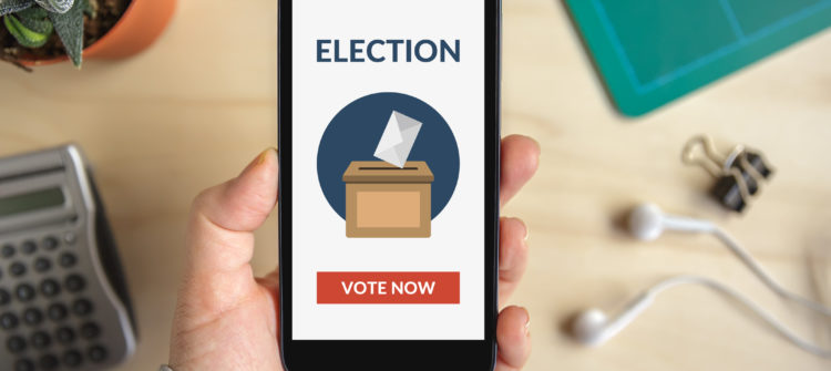 a photo of a hand holding a phone with online voting