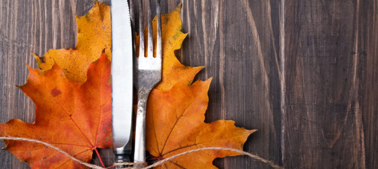 a photo of autumn leaves, a knife, and a fork