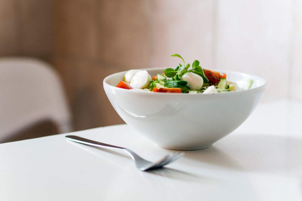 a photo of a bowl of salad