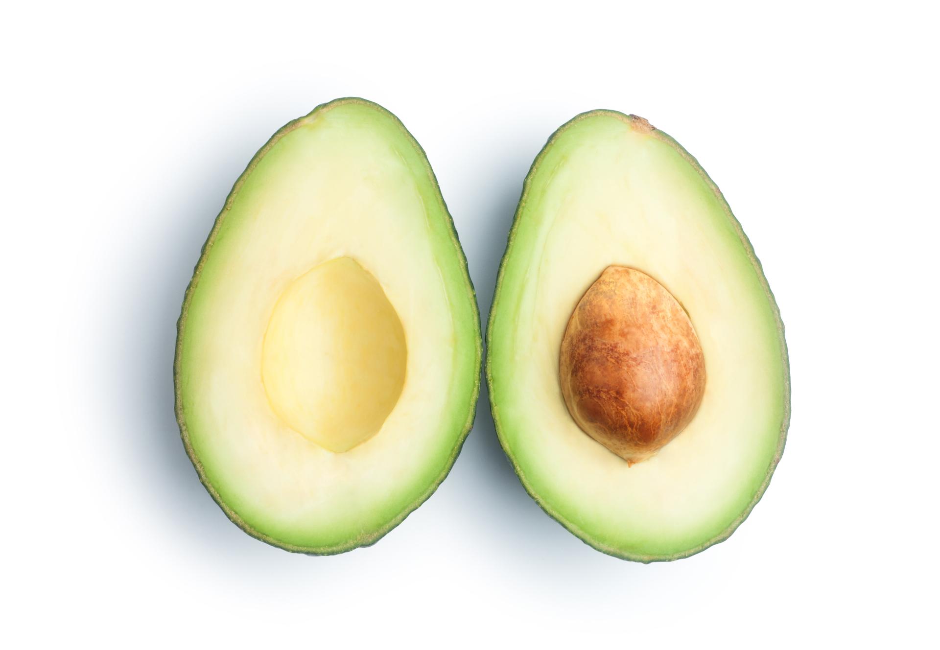 a photo of a ripe avocado split in half