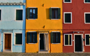 a photo of three brightly colored buildings in Mexico