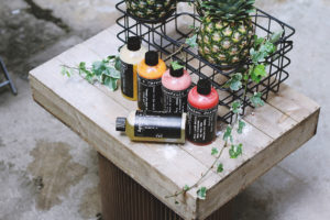 a photo of shampoo, a pineapple, and a plant