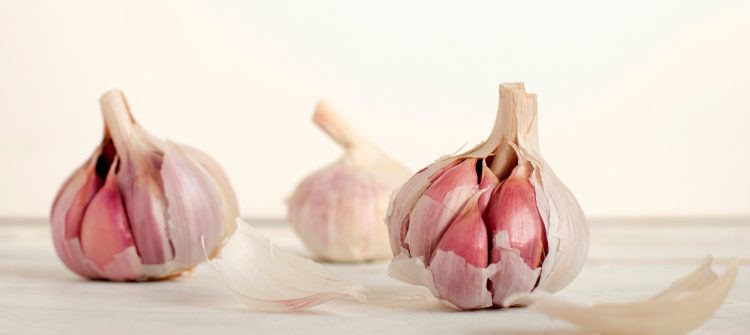 a photo of three cloves of garlic