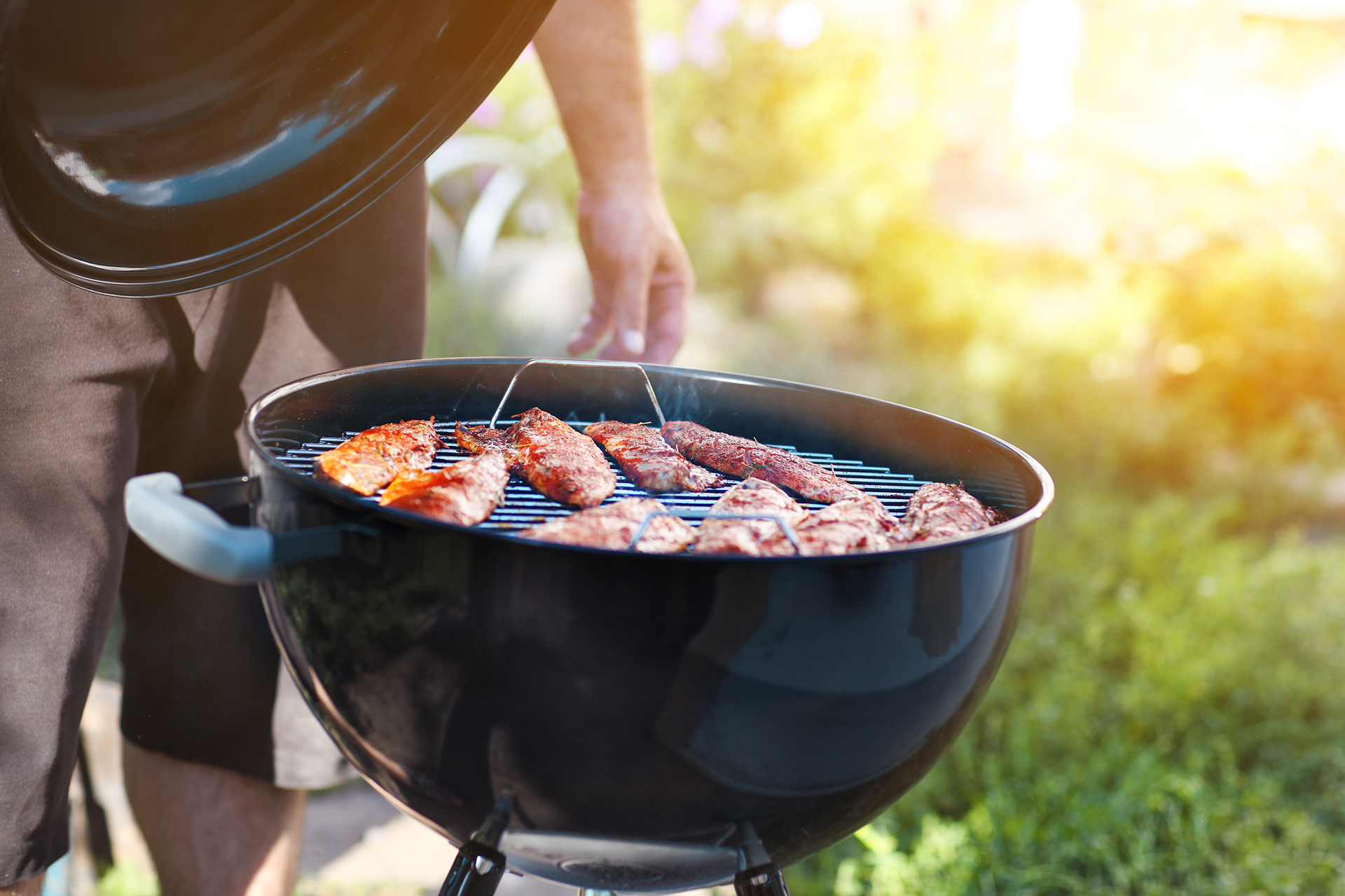 a picture of a person grilling fish outside