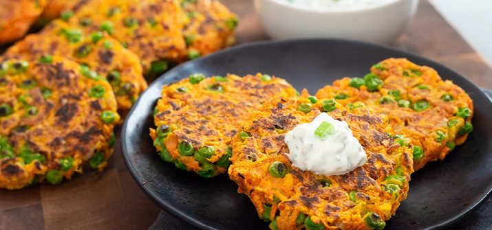 a photo of carrot pea fritters on a plate