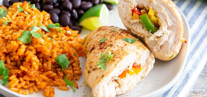 a photo of baked chicken fajita roll ups with beans and rice
