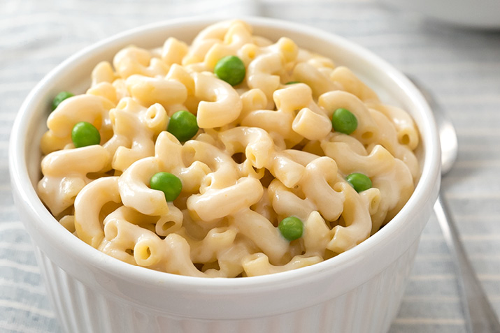 a photo of mac and cheese with peas