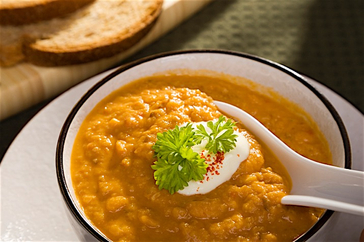 a photo of red lentil soup