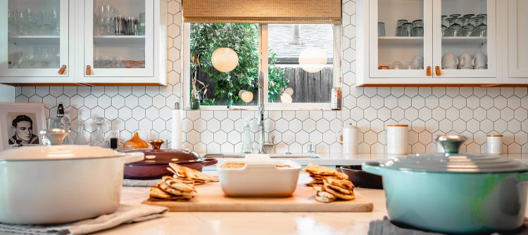 a photo of a kitchen with dishes on the counter