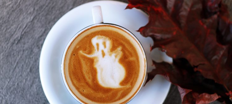 a ghostly latte with a crunchy autumn leaf