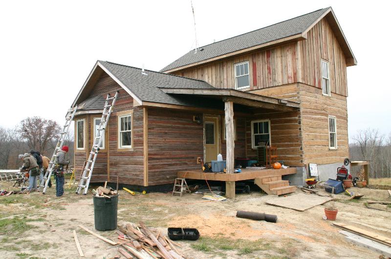 Restored 1860 log cabin house at East Henderson Farm