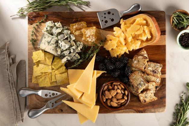 a cheese board with nuts and crackers