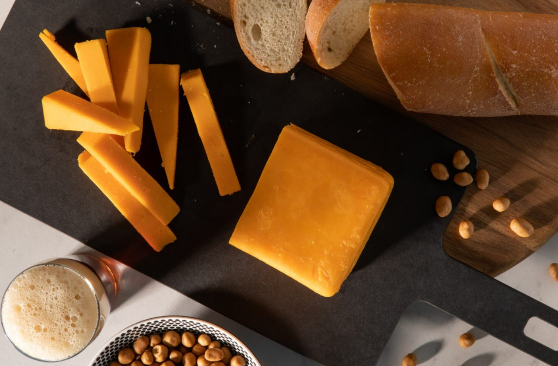 a cheese board with bread and nuts